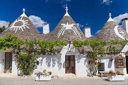 Trulli-Dörfer in Apulien mit Weinreben